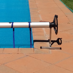 Pool cover roll-up station
